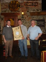 The overall winner Dermot receives his prize from the captain and sponsor Pat
