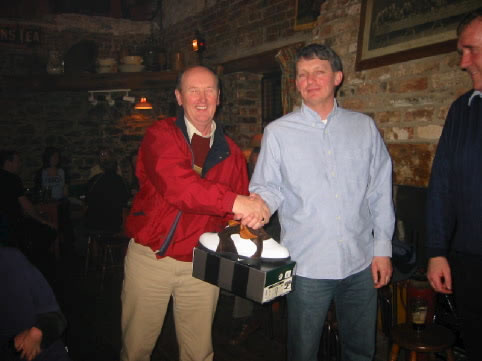 Pat presents Brendan with one of his many prizes