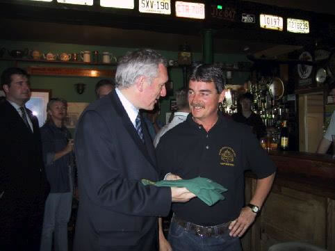 Captain John Dunne presents An Taoiseach with a society Polo Shirt on his visit to the Schooner in 2001