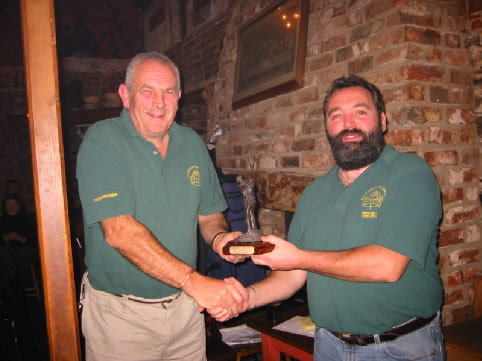 Jim Kehoe Presenting Rob Millard with the R/Up prize in the first Schooner Matchplay competition trophy