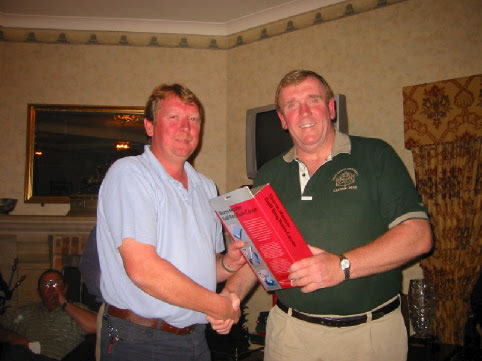 Jimmy Loughlin collects the odd prize
