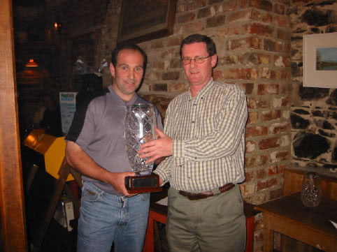 "John Sweeney, Sponsor, Presenting Milo O'Connor with the ""First Glass Golfer of the Year"" trophy in 2002"