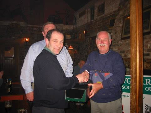 Milo O'Connor receives one of his many prizes from Terry Hobdell