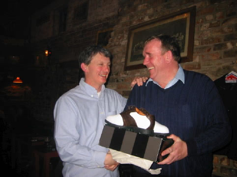 Even the Secretary, Dermot Hobbs, gets the odd prize from Brendan Malone