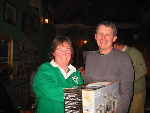 Sponsor Brendan Malone presents a prize to Theresa, March 2004